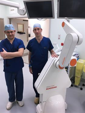 Mr Martin Tisdall and Kristian Aquilina with the neuromate robot